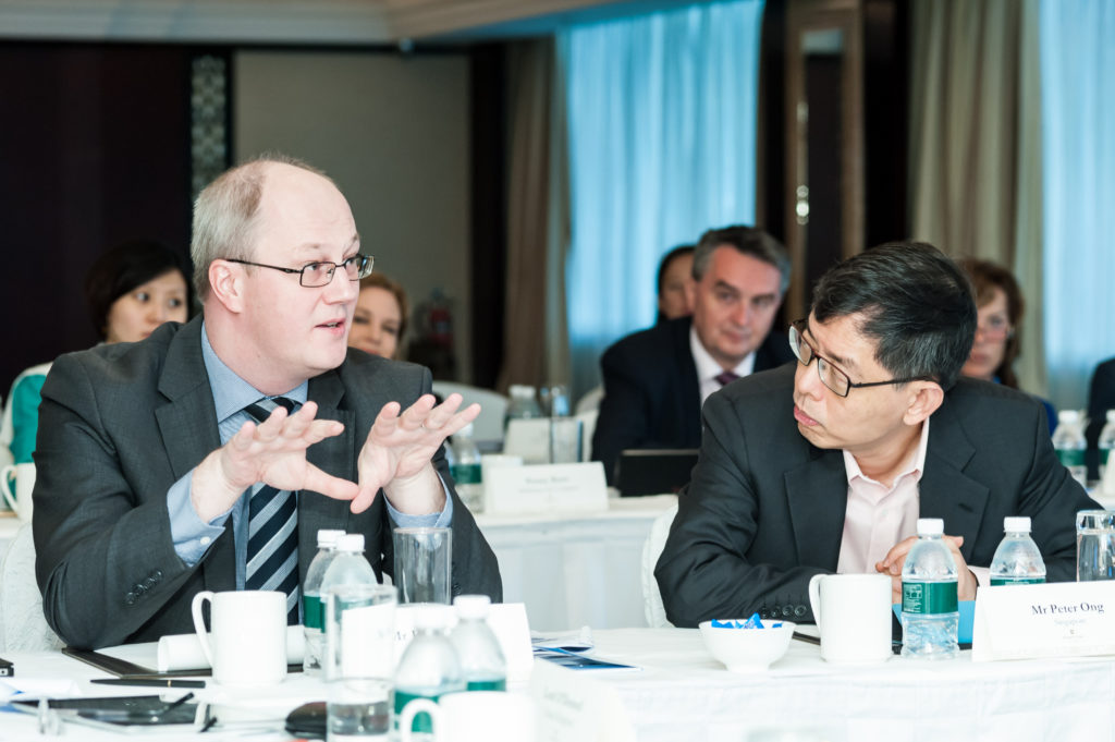 Heiki Loot, state secretary, Estonia (left) and Peter Ong head of civil service, Singapore (right), in discussion at the Global Government Summit, November 2015.