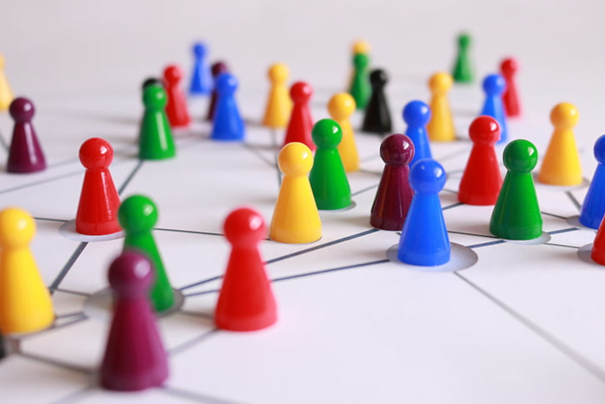 Multicoloured markers on white map