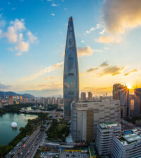 Lotte World Tower against blue sky.